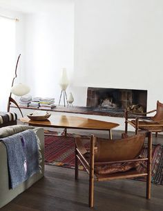 love this room arrangement with the low, wide fireplace and extended  bench.