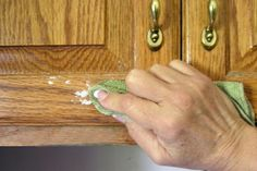 Greasy cupboards: Sprinkle Baking soda on a clean wet cloth and scrub. Rinse with clean water and dry towel. Baking soda will not scratch the cabinets.