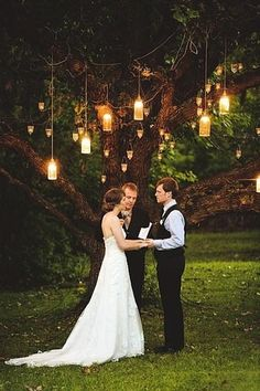 This may be my favorite of all but it demands sunset ceremony (which minimizes photography time...) Altar tree backdrop with hanging lanterns, summertime wedding, green wedding, outdoor wedding