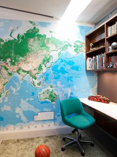 Fantastic boy's bedroom with world map wallpaper accent wall, teal blue desk chair, skylight and green shag rug. Boys Room Design, Boys Room Decor, Playroom Decor, Girl Room, Kids Bedroom, Kids Rooms, World Map Wallpaper, Boys Wallpaper, Interior Design Inspiration