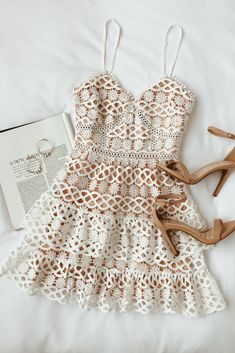 White and Nude Crochet Lace Mini Dress! Stunning crocheted lace, with pierced accents, shapes eye-catching crochet lace atop a nude-colored, sleeveless bodice and adjustable spaghetti straps. Mode Outfits, Fashion Outfits, Fashion Hacks, Dress Fashion, Fashion Ideas, Fashion Tips, Fashion Trends, Casual Dresses, Summer Dresses