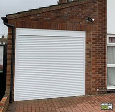 At Garolla, our electric garage door cost includes expert measuring, fitting & VAT. Within each electric garage doors price is also a guarantee. Click the link to see our roller garage doors sale.  #garage #garagedoor #garagedoors #garageinspiration #newgarage #newgaragedoors #whiteexterior #whiteinterirdesign #whitegarden #whitegaragedoorideas #whitegarage