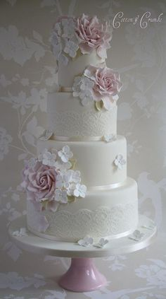 Rose & hydrangea wedding cake idea. like the use of lace and hydrangea, but would use purple tulips instead of roses. #purpleweddingcakes #laceweddingcakes