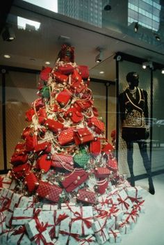 #Chanel bag Christmas tree. Deck the halls with boughs of Coco... Vintage Holiday Window Displays at Stores Around the World: Condé Nast Traveler