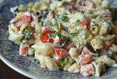 Roasted Garlic, Olive & Tomato Pasta Salad ~ This is a Summer salad but could be served at any potluck or football gathering. ~ The recipe serves 6 as a side or 4 as a main dish.