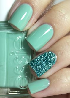 Fun but I would NEVER be able to keep myself from picking the beads off.  Essie Turquoise & Caicos my new favorite nail color. Also, the cavier nail design on the single ring finger is super cute.