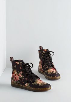 Peaks and Creeks Boot. Whether traversing mountains or meadows, these black floral boots by Dr. #black #modcloth