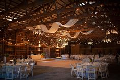 Twinkle lights and fabric draping gave this rustic Catskills barn venue a romantic feel {Carly Abbott Photography}