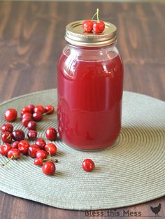 Homemade cherry juice - perfect for drinking, jellies, and syrup. Bottled to save for winter -no artificial anything! (mason jars)