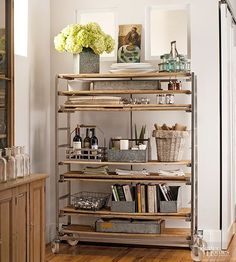 Salvaged industrial carts and shelving units substitute beautifully for traditional pantry cabinets. Here, weathered galvanized containers, toolboxes and mail baskets perform in sync with the shelf's manufacturing plant beginnings.