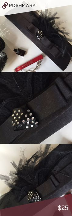 """BLACK EVENING CLUTCH WITH FEATHERS Black evening clutch with inside rings if you want to add a strap from an existing bag. Front snap closure on a sleek satiny matte finish fabric with a plume of black feathers set on faux bow with rhinestone center knot. The bag has an inside compartment & plenty of room for your essentials. The bag measures 12""""x4"""" & looks fab with red or animal prints!! Bags Clutches & Wristlets"""