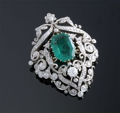 Beautiful millgrain work, fab setting.. Im guessing vintage. Not sure of the hallmark of total carat weight