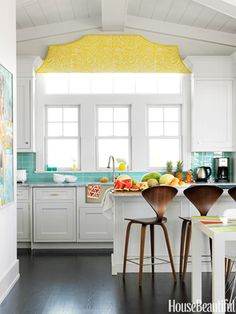 Backsplash  The fanciful valance in Arcadia Sulphur by Raoul Textiles and the Modwalls glass tile backsplash add some excitement.