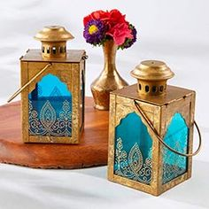 No Indian wedding decor is complete without Kate Aspen's beautiful jewel tone lanterns. Blending the elegance of the West with the vibrance of the East, these luminous decor elements feature an antique gold finish and sapphire blue glass with an exo Gold Lanterns, Lantern Centerpieces, Wedding Lanterns, Blue Candles, Candle Lanterns, Tea Light Candles, Tea Lights, Lantern Decorations, Dance Decorations
