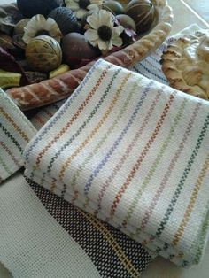 Rigid Heddle Cornucopia of Color Towels. Weave colorful fall colors to your heart's delight with our extra-absorbent, all-natural Aurora Earth 8/2 100% cotton. It's fun to play with color in the warp, producing a bounty of colored stripes. Natural is used in the weft making the colors in the warp pop.
