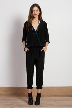 The Ella wrap jumpsuit in black silk with navy trim. Made in New York.