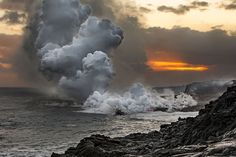 Steam rises when Lava from Kilauea Volcano pours into ocean at Kamokuna