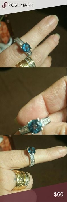 Brilliant blue topaz ring Sterling silver with beautiful diamond accent on the side. Jewelry Rings