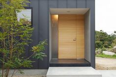 Exterior Exterior Front Door Designs for A Perfect Outer Look: Wonder Inside Exterior Front Door Design With Light Color Wooden Laminate Material Besides Matte Glass And Dark Grayish Painted Wall Also Concrete Stair