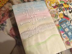 WRECK THIS JOURNAL 5.) I water colored the back of the cover in light pastels and used a correction pen to write the day I began the journal