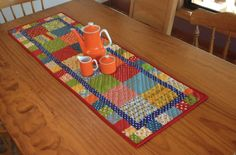 """Use a charm pack or any 5"""" squares to make this'Charming' PatchworkTable Runner Size 15"""" x 46"""" Requirements 1 Charm pack or 34 5"""" squares - remember a Layer Cake cut into quarters makes 5 Charm..."""