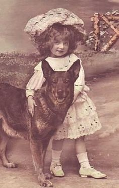 Antique Sepia Photo of little girl with her Large German Sheperd Dog. (pin thanks to: Dolly Macabre)