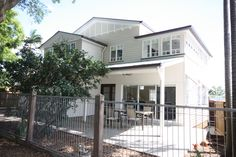 Queenslander Renovation. Lifted and built under with 3 bedrooms, 2 bathrooms upstairs and open plan living and dining on ground floor.