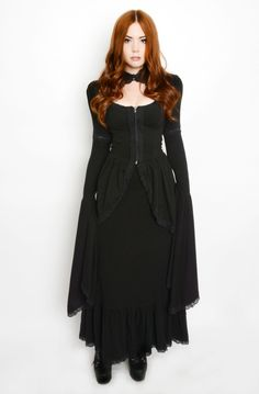 This Stunning dress is inspired by late Victorian fashion. Dress is fully lined and professionally finished with serged seams. It has puff sleeves and a skirt, soft thick patterend stretch fabric, dec