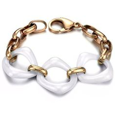 Designer Style Bold White Ceramic Bracelet with Rose Gold Plated Links Flying Colors. $29.98. Promptly packaged with free gift box. Gift box may be different from the picture.. Fine Ceramic and high quality stainless steel.. Featuring three open ceramic rings. Perfect craftmanship.. Designer style. Bold and expressive.. Express your self with these bracelets.. Save 66%!