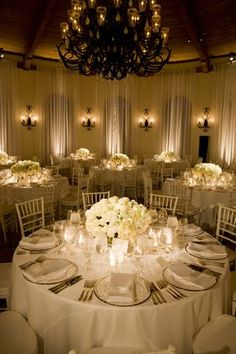 Gold, ivory and white wedding reception decor with white florals in ...