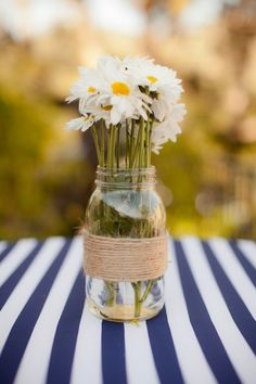 I love how simple using used jam jars can be and how lovely they look once you've added some fresh flowers to them.
