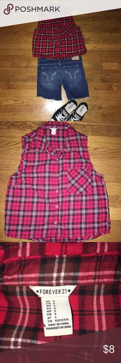 Forever 21 plaid flannel crop shirt red grunge S Forever 21 Sz small . Listing is for Shirt ONLY. Plaid button front flannel crop shirt. Free of holes or stains, freshly laundered & ready to ship. Smoke free home, as ?'s prior to purchase, all sales are final. Measurements are approximate. Chest ; 39 inches-length;22 inches . One chest pocket & tiny slide slits at side. Forever 21 Tops Button Down Shirts