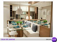 A mesa retangular com o sofá lateral é um coringa na decoração de ambientes pequenos, pois deixa livre a circulação do ambiente, poupando espaço. Uma dica, o espaço embaixo do banco ou sofá ainda pode ser usado para guardar objetos e coisas.