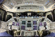 """The cockpit of space shuttle orbiter """"Atlantis"""" in the unpowered state (Powered up state is seen here at Photo ID 2090199. At this point she was a few weeks away from her final retirement configuration which involved a lot of permanent disabling of systems. She is preserved in this state for eternity on the inside."""