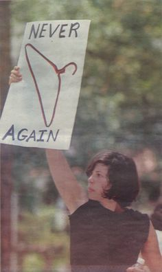 """""never again"" This image is one of the most powerful pro-choice images I've ever seen. When I saw it in the newspaper I immediately cut it out and hung it on my wall. This is not my image. I'm using it with permission from Arthur Newspaper"