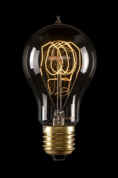 Лампа с угольной нитью. Срок жизни -  1000 часов. Именно такие придумал Эдисон.