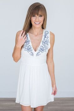 Shop our Sleeveless Floral Embroidered Dress in Off White. Featuring cutout side details and an open back. Free shipping on all US orders!