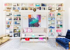 bright colorful built in bookshelf living room clear glass coffee tables bright wall art