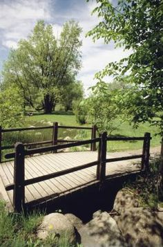 How To Build An Arched Footbridge With Posts & Rails