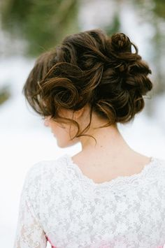 Wedding Updos That Are Beautiful From Every Angle #refinery29 http://www.refinery29.com/bridal-guide/26#slide-6 The loose tendrils are a major part of why this look works....