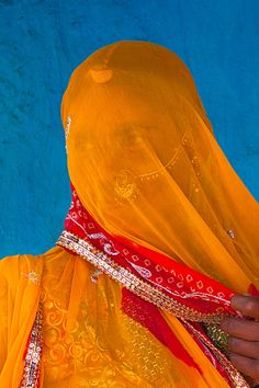 Veiled Hindu woman in a village near Kumbhalgarh, Rajasthan, India,,,By Jim Zucherman