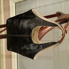 Cute handbag Black faux leather, lined, with  tan stitching and 2 inside zipper pockets and snap closure Nine West Bags
