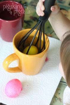 Put an egg inside of a whisk, then toddlers can dye them on their own.
