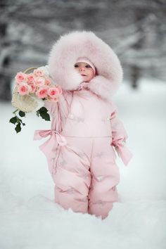 Cutiepie in pink snowsuit bringing roses for mommy*****Follow our unique garden themed boards at www.pinterest.com/earthwormtec *****Follow us on www.facebook.com/earthwormtec for great organic gardening tips #children #garden #snow