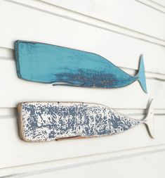 These two wooden whales were created with driftwood salvaged from the same boat wreck last year. I added layers of blues with lots of sanding in between  and decided to keep the design simple. .  .  .  .  ©MadeByCBK  #bluewhale #denim #bluejean #nantucketstyle #capecod #whaleart #etsy #madebycbk #azul #bleu #colorventures #anniesloanchalkpaint #coastalliving #driftwoodwhale #baleine #hval #beachclean #surfriderfoundation #healthebay #colorventures #texture #dscolors