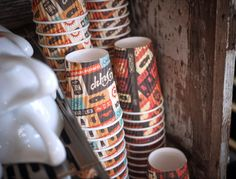 These corrugated cups don't require holders... and the graphics are retro-cute too