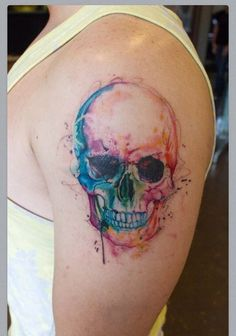 colorful skull watercolor tattoo on shoulder - teeth