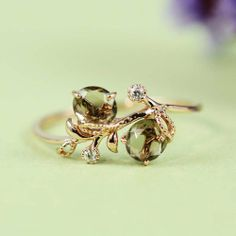 Green amethyst gold engagement ring
