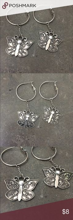 """Silver Tone Butterfly Hoop Earrings Approximately 2"""" in length these pretty butterfly earrings would look great with any outfit.  Butterfly charms hanging from silver tone hoops. Jewelry Earrings"""