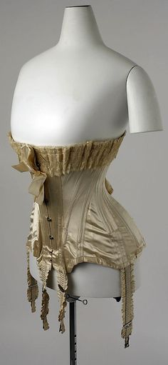 French corset, 1907 Dimensions: Length at CB: 14 in. (35.6 cm) Length at CF: 12 in. (30.5 cm) Length at Side Seam: 13 in. (33 cm) Again tiny waist and hint of S-line silhouette
